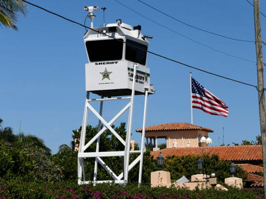 FILE - In this April 7, 2017, file photo, a Palm Beach, Fla. County Sheriff's lookout tower sits outside of President Donald Trump's Mar-a-Lago resort in Palm Beach, Fla.  It's widely estimated that each trip to the resort costs taxpayers $3 million, based on a government study of the cost of a 2013 trip to Florida by President Barack Obama. But that trip was more complicated and the study's author says it can't be used to calculate the cost of Trump's travel. This weekend, Trump is making his seventh visit to Mar-a-Lago since becoming president.