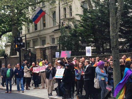 """People protest outside the Russian Embassy in London, following reports of the torture and murder of gay men in Chechnya, Wednesday April 12, 2017. The United Nations' High Commissioner for Human Rights called upon the Russian government in a statement """"to put an end to the persecution of people perceived to be gay or bisexual, while Chechen authorities denied the reports, and spokesman for leader Ramzan Kadyrov insisted there were no gay people in Chechnya."""