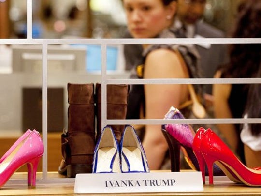FILE - In this Aug. 23, 2012, file photo, shoes from the Ivanka Trump collection are displayed at a Lord & Taylor department store in New York. Retailers are trying to figure out a way to deal with the politically charged Ivanka Trump brand, stamped on everything from shoes to pants to handbags. The products have become more polarized with President Donald Trump's rise to The White House, and retailers are trying to be careful not to offend shoppers from both sides of the political aisle.