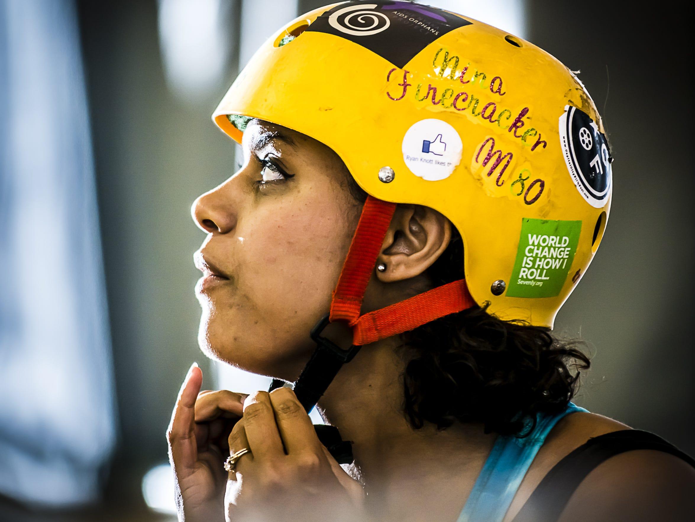 Tashmica Torok dons her helmet