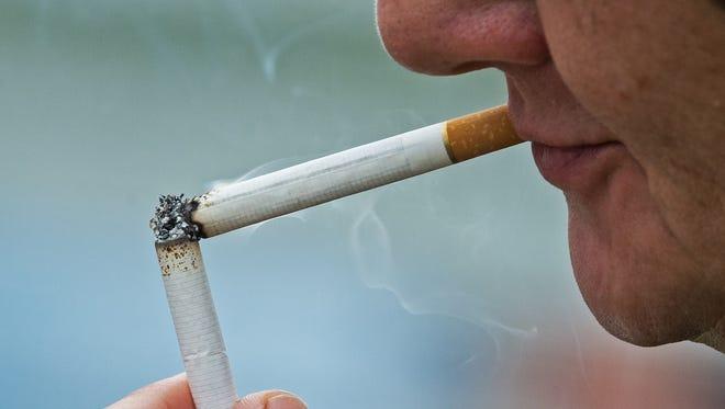 A woman takes a cigarette break in Wise, Va.