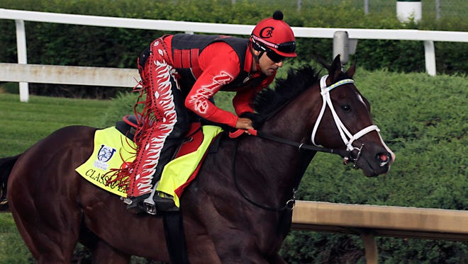 Exercise rider Martin Rivera gallops Kentucky Derby hopeful Classic Empire at Churchill Downs in Louisville, Ky., Wednesday, May 3, 2017. (AP Photo/Garry Jones)