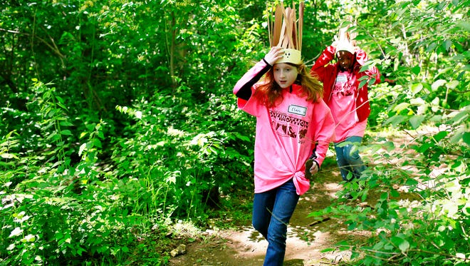 In this file photo, third-graders and team Positive Power Porcupines Clare Seifert, front, and Milan Gerald, both of Hayshire Elementary School, compete in the Scavenger Hunt during the 2017 Envirothon at John C. Rudy County Park in East Manchester Township, Tuesday, May 9, 2017. The park is one of 16 in York County that have benefited from the Land and Water Conservation Fund.