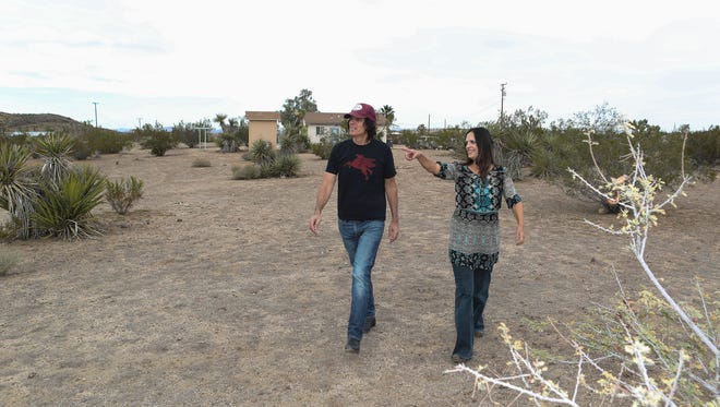 Jill and Ed MIchaels are hoping the city of Yucca Valley will allow pot cultivating operations to help bolster the local economy. Their land is situated in an industrial zone and could be sold to pot growers.