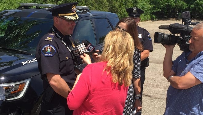 Todd Mutchler, Northville Township's public safety director, speaks Wednesday with members of the media about the evacuation of the Meijer on Haggerty and the bomb threat there.