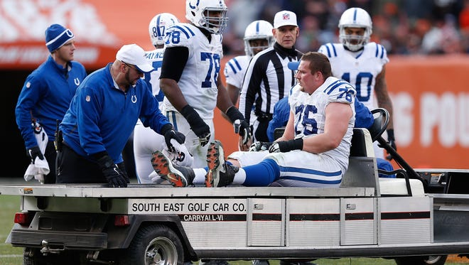 Joe Reitz of the Indianapolis Colts is carted off the field during the third quarter against the Cleveland Browns at FirstEnergy Stadium on Sunday.