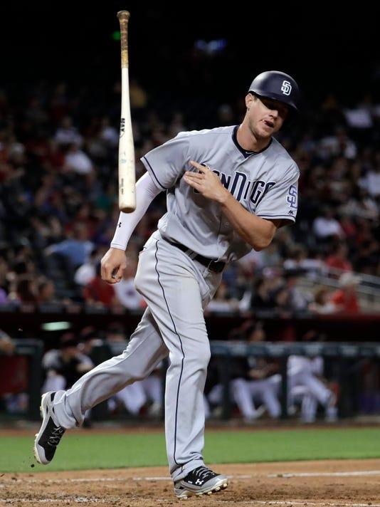 San Diego Padres' Wil Myers tosses hit bat after hitting a three run home run against the Arizona Diamondbacks during the seventh inning of a baseball game, Monday, April 24, 2017, in Phoenix. (AP Photo/Matt York)