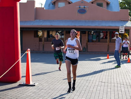 Teah Roga, 15, crosses the finish line in third place