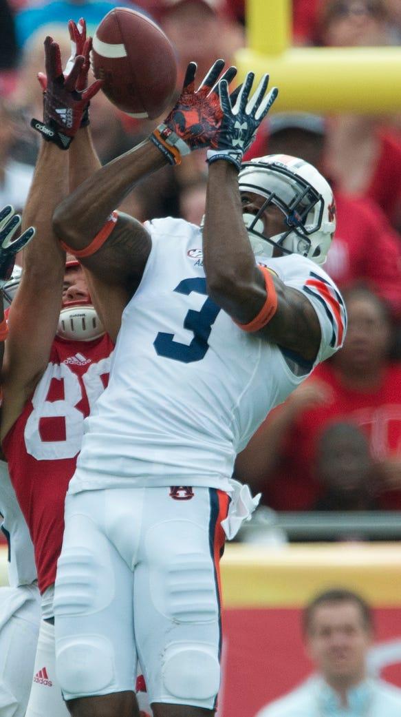 Auburn defensive back Jonathan Jones (3) deflects a
