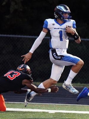 Grain Valley quarterback Cole Keller (1), who has already received several college offers to play football, is busy preparing for the basketball and baseball seasons as well.