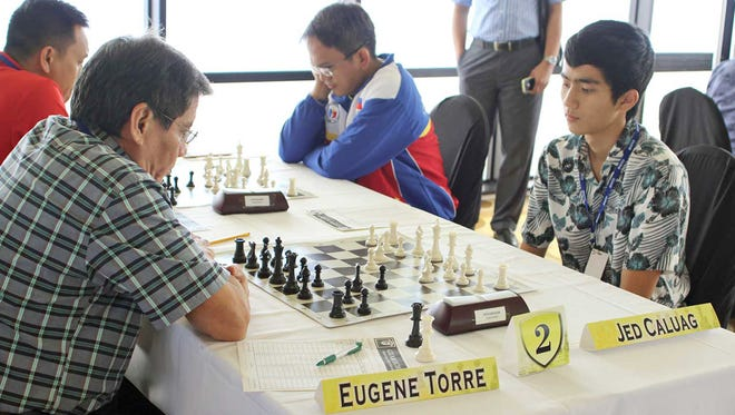 In this 2015 file photo, Jed Caluag challenges Eugene Torre during the Guam International Chess Tournament.