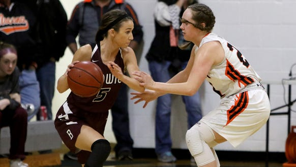 Bowie's Kamryn Cantwell dribbles around Nocona's Averee Kleinhans in a December district game. They've both been two of the best area girls scorers this season.