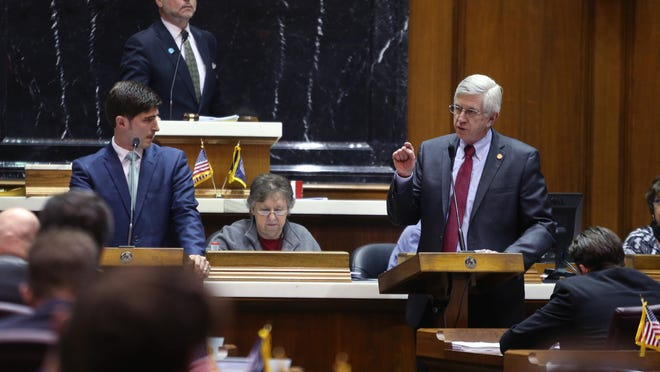 Rep. Ed Delaney, D-Indianapolis (right), questions Rep. Tim Wesco, R-Osceola (left), House sponsor of SB 101, the Religious Freedom Restoration Act, at the Statehouse in Indianapolis before the House approved it 63-31 on Monday, March 23, 2015. Supporters say the legislation would protect religious freedoms, but opponents say it would allow discrimination against gays and lesbians.