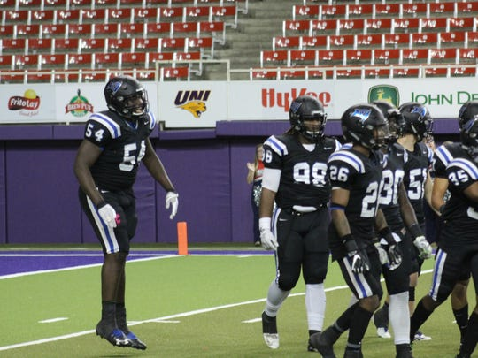 Daviyon Nixon (54) gets ready for a play during the Graphic Edge Bowl while playing for Iowa Western in the UNI Dome.