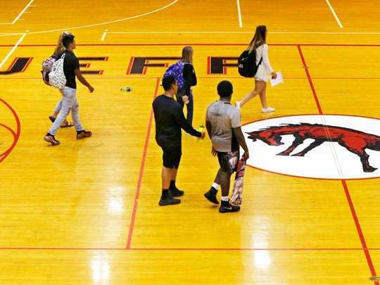 Students pass through Crawley Center at the end of the school day Tuesday, October 3, 2017, at Lafayette Jefferson High School.