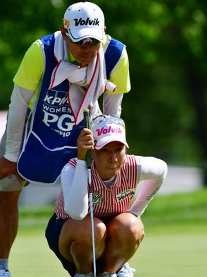 Chella Choi and her caddy -- her father -- line up a putt during the third round of the KPMG Women's PGA Championship at Olympia Fields Country Club - North.