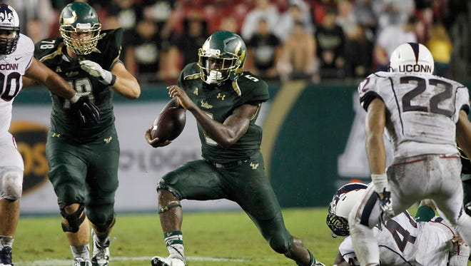 South Florida Bulls running back Marlon Mack (5) runs with the ball during the second half against the Connecticut Huskies at Raymond James Stadium. The Bulls won 17-14.