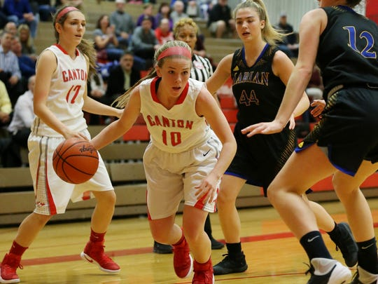 Canton guard Alaina Heitmeyer (No. 10) goes up against Marian defenders Olivia Moore (No. 44) and Isabel Hayes (No. 12) during Tuesday's game. At left for the Chiefs is Ashley Criscenti.