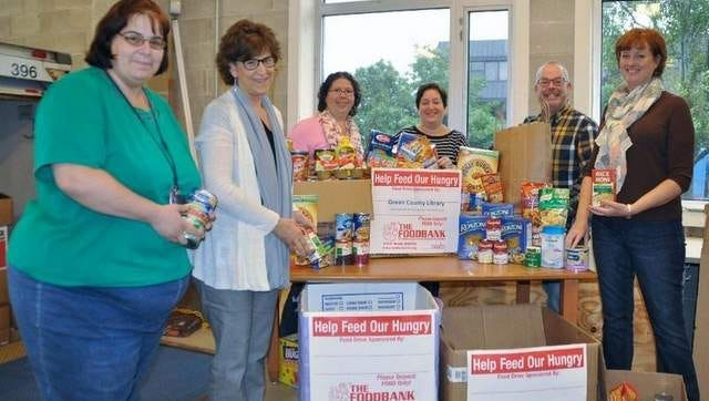 Library personnel help load a truck bound for the Foodbank of Monmouth and Ocean Counties. Nearly 5.4 tons of food were collected during OCL's Food for Fines project held in September.