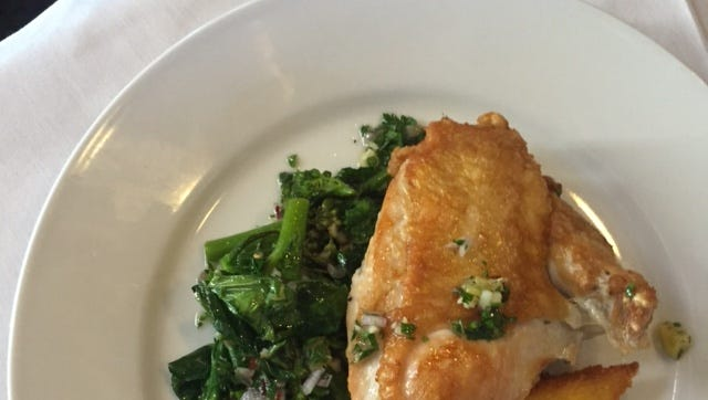 Pan roasted chicken breast with broccolini, crispy polenta and preserved lemon.