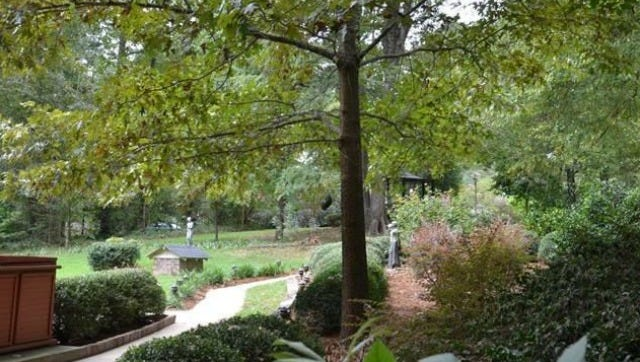 The Northwest Louisiana Master Gardeners' Le Tour des Jardins  tour features seven private gardens, including that of Bazanna White, shown above.