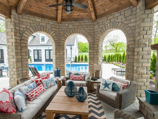 """We haven't built a house without a covered outdoor living space,"" said Trey Pettis, president of Pettis Builders, which has build more than 40 homes in Foxland Harbor. ""We design a lot of homes around the golf course or lake views."""