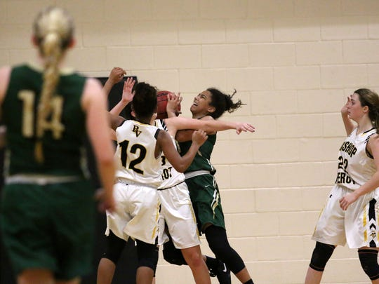 St. John Neumann's Chanel Whooley attempts to shoot during the Girls 5A-10 District Championship at Bishop Verot on Thursday, Feb. 2, 2017.