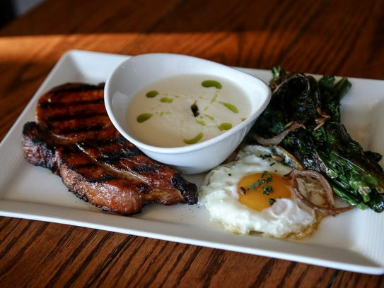 Pork chop, sesame kale, sunny side Circle V egg and