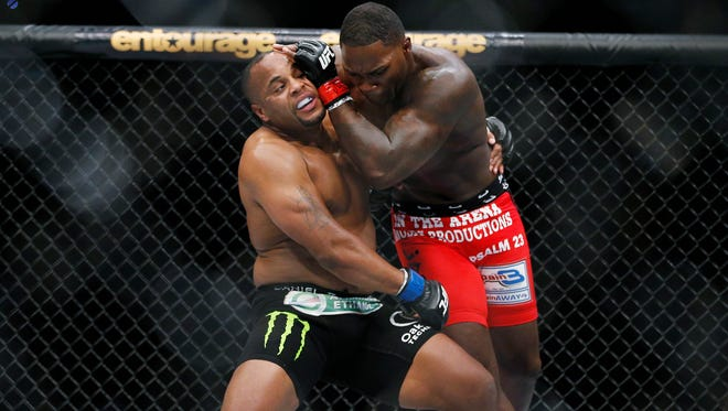 Daniel Cormier, left, and Anthony Johnson duel in the light heavyweight title bout at UFC 187 on May 23, 2015, in Las Vegas. UFC light heavyweight champion Cormier is set to fight Johnson in the main event of UFC 210. Cormier defeated Johnson in their first bout in 2015.