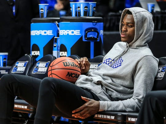 Kentucky's Jarred Vanderbilt looks a bit glum while watching his team practice Wednesday, March 14, 2018, before the Wildcats' opening game against Davidson in the Taco Bell Arena in Boise, Idaho. In late September, Vanderbilt fell to the ground with a left foot injury during a drill in practice that cost him more than three months of practice and games.