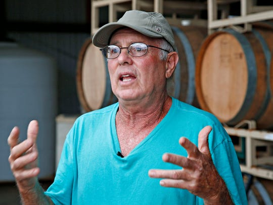Sam Pillsbury. owner of Pillsbury Wine Company, in his barrel room, voicing concern about the scenic and economic impact over a proposed site for a 250 foot tall, high tension power line in Willcox on August 30, 2015. The wineries are afraid of adverse effects on wine tourism if the proposed lines go through.