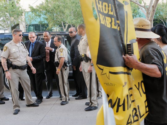 O.J. Simpson, third from left, and his friend Tom Scotto, of Naples, second from left, arrive at the Clark County Regional Justice Center on the second day of jury selection for his trial in Las Vegas on Sept. 9, 2008. Simpson faced 12 charges, including felony kidnapping, armed robbery and conspiracy.