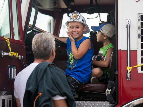 Daniel McGinnis, 6, and his brother Jake, 5, check