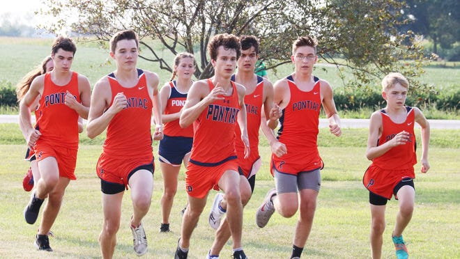 Members of the Pontiac cross country team take off at the start of a meet held Tuesday at the Rec-Plex.