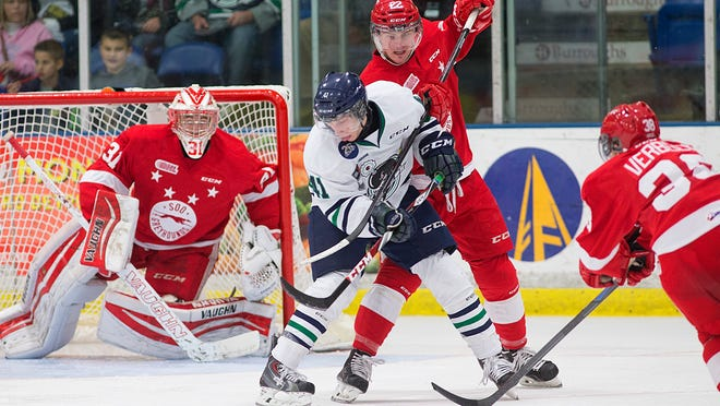Will Bitten (No. 41) of the Plymouth Whalers backhands the puck toward Sault Ste. Marie goalie Brandon Halverson during Saturday night's OHL game at Compuware Arena.