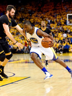 Golden State Warriors forward Harrison Barnes (40) drives to the basket against Cleveland Cavaliers forward Kevin Love (0) during the third quarter in Game 5 of the NBA Finals at Oracle Arena.