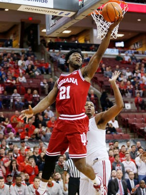 Indiana forward Freddie McSwain Jr., left, goes up for a shot against Ohio State forward Kaleb Wesson during the first half of an NCAA college basketball game in Columbus, Ohio, Tuesday, Jan. 30, 2018.