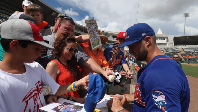 Tim Tebow, of the St. Lucie Mets, signs autographs before a game against the Fort Myers Miracle at Hammond Stadium on Monday, July 17, 2017.