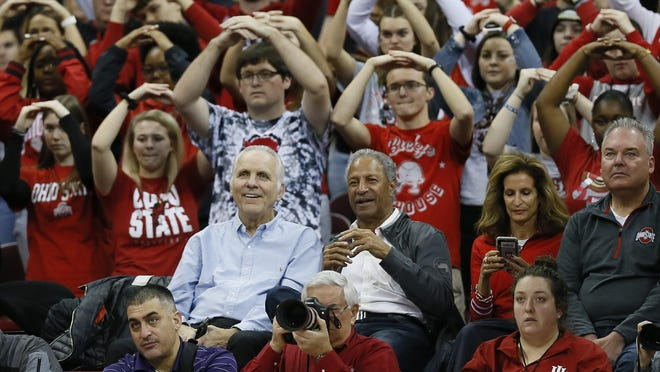 Jerry Lucas, left, and Mel Nowell sit together at a recent Ohio State men's basketball game in the Schottenstein Center. Both were members of the 1960 national championship team.