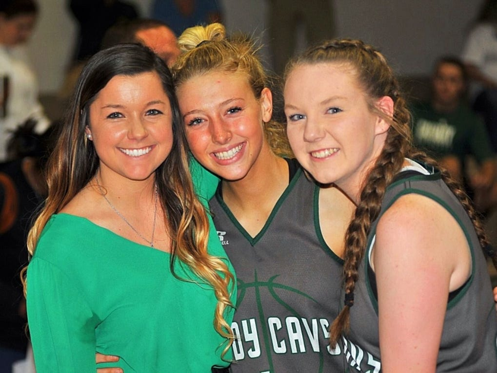 Calvary coach Rhonda Martin (left) with players Gussie Treadway and McKenzie Knotts at a game earlier this season.