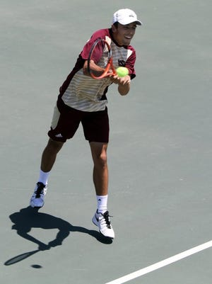 Lauren Roberts/Times Record News Midwestern State's Ramon Toyos returns the ball in the NCAA Division II South Central Region playoff doubles match against St. Edward's Saturday, May 7, 2016, at the MSU Tennis Courts.