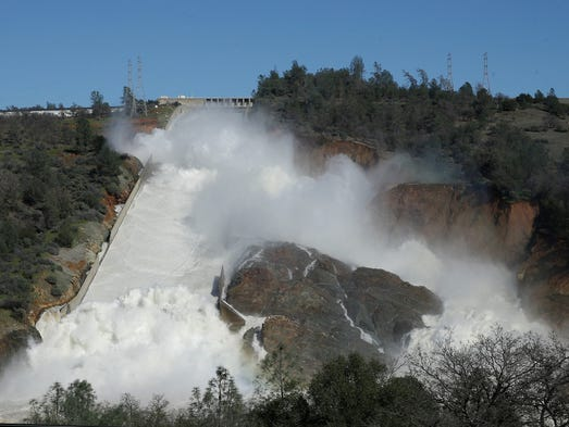In this Saturday, Feb. 11, 2017, water flows down Oroville