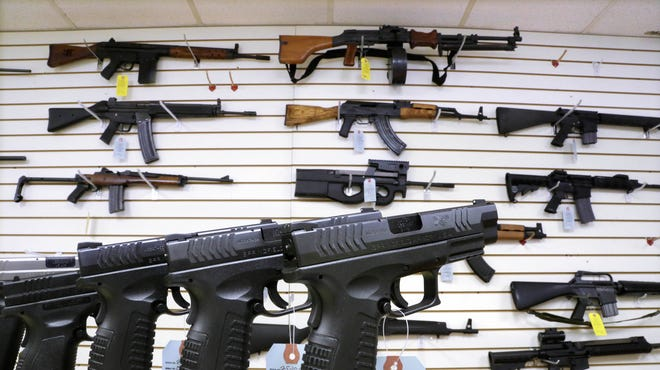 Assault weapons and hand guns are seen for sale at Capitol City Arms Supply in Springfield, Ill., in 2013.