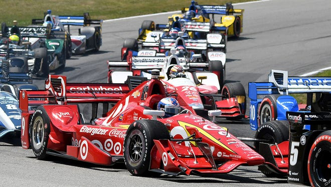 """Scott Dixon tries to work his way through the traffic in """"The Esses"""" at the Mid-Ohio Sports Car Course during the 2016 Honda Indy 200."""
