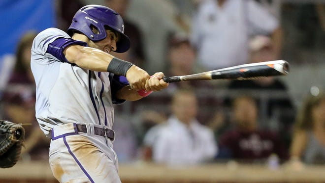 TCU's Ryan Merrill (5) hits a two RBI double against Texas A&M's during the fifth inning of an NCAA super regional baseball tournament game on Friday, June 10, 2016, in College Station, Texas.