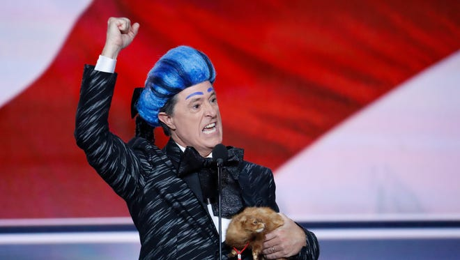 Comedian Stephen Colbert clowns around on the stage at the Republican National Convention in Cleveland, on July 17, 2016.