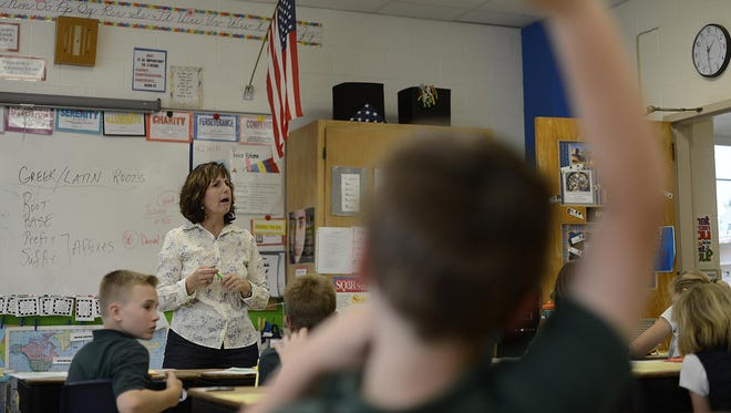 Kathy Schumacher teaches Greek and Latin roots inside her fifth-grade class at St. Matthews and Resurrection Catholic School in Green Bay on Wednesday, May 20, 2015.