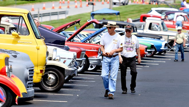 George Slover, left, of Middletown, New York, and Jay Wayne, of Newbaugh, New York, walk the line of cars as National Street Rod Association members arrive for the Street Rod Nationals East event registration at Wyndham Garden Hotel in West Manchester Township, Thursday, June 2, 2016. Dawn J. Sagert photo