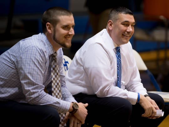 Harper Creek head coach Matt Bowling, right, and assistant
