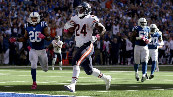 Chicago Bears running back Jordan Howard (24) walks in by Colts defenders on a 21-yard touchdown reception in the second half of their game. The Indianapolis Colts host the Chicago Bears in their NFL football game Sunday, October 9, 2016, afternoon at Lucas Oil Stadium.